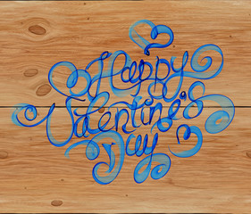 Happy Valentines day vintage lettering written by fire or blue smoke over wooden background