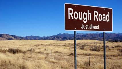 Rough Road brown road sign