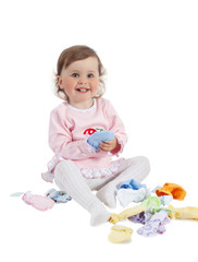 Baby playing with baby clothes, isolated on white background