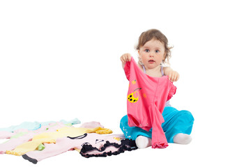 Charming baby playing with clothes, isolated on white background