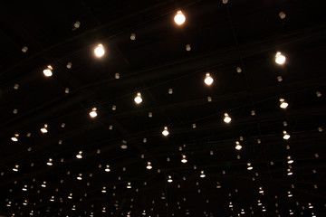 Exhibition hall with ceiling lights background
