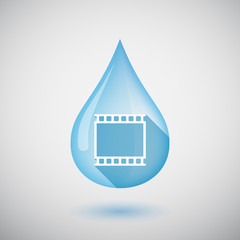 Isolated water drop with   a photographic 35mm film strip