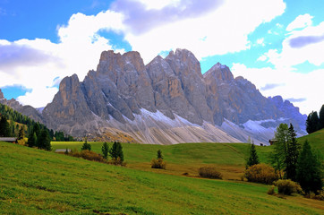 Colors of Dolomites. funes view of the valley, Puez-Odle in autumn. at sunset holy magdalena. View of odle mountain