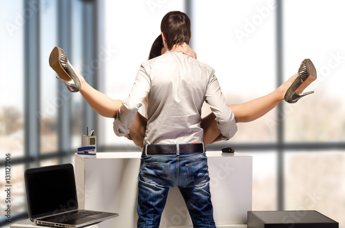 Young beautiful couple having sex in the office Stock
