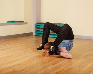 Man doing stretching after training. Healthy lifestyle concept. Fitness.