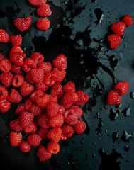 Fresh raspberries, black background