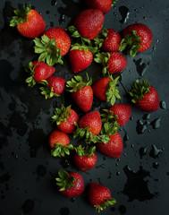 Fresh strawberries, black background