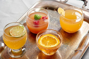 Glasses of juice on silver tray