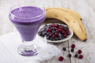 Smoothie of banana, pineapple, cranberry and blueberry  with yog