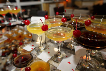 Alcoholic drinks, bartender made colorful cocktails for alcohol party