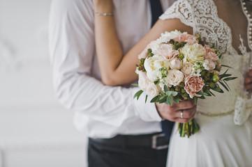 Embrace of the newlyweds close up 7057.