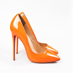 Female orange shoes over white