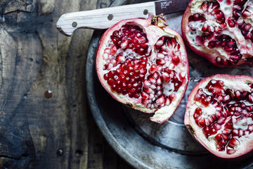 Halved pomegranates on plate