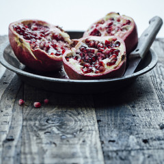 Halved  pomegranates in bowl