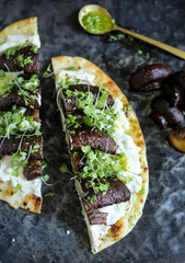 Open sandwich of roast mushroom and ricotta