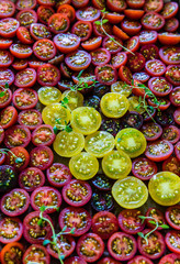 Halved red and yellow tomatoes