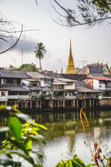 River, apartments and temple spire, Chantaburi , Thailand, Asia