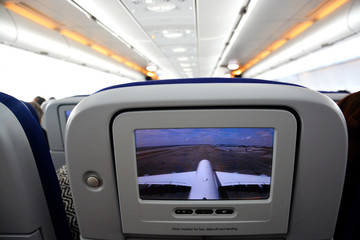 Interior of commercial aircraft- close-up of LCD rear seat showing live images from outside the plane