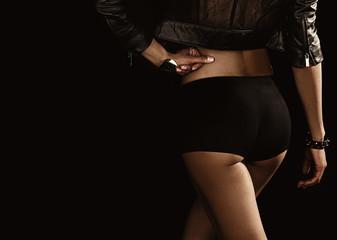 Close up photo of beautiful sexy young woman wearing tiny shorts