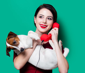 woman with red handset and dog