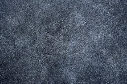 Dark stone or slate wall.