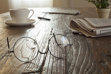 newspaper over wooden table