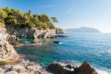 Rocky coastline near Genoa during a sunny winter morning Wall mural