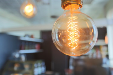 Yellow vintage electric lamp in a cafe