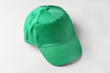 Blank green baseball cap on white background