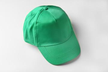 Blank green baseball cap on white background