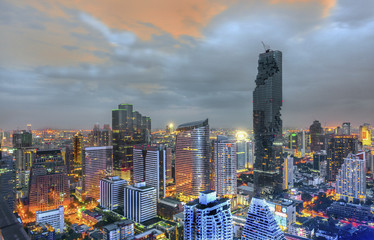 Aerial view of Bangkok modern city of commercials, trading areas, downtown with sunset sky , Bangkok , Thailand
