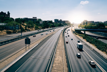 Madrid highway with sunlight on background