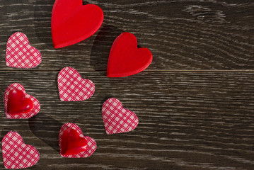 Decorative items for the celebration of Valentine`s Day on a wooden background