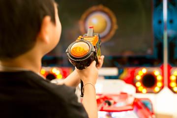 Children play shooting gun in game vending machine