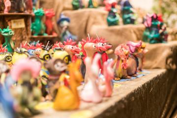 Handmade wax figures at busy Breitscheidplatz Christmas market, Germany