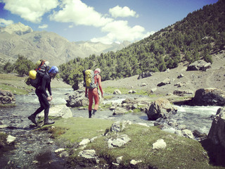 Man tourist walking the mountains with a backpack.