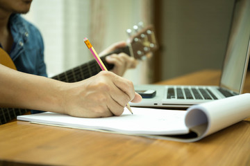 Selected focus on pencil songwriter working on new composition