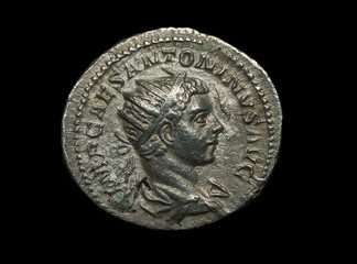 Ancient silver roman coin isolated on black