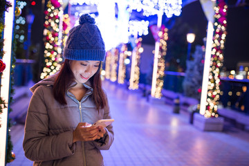 Young woman using mobile phone at night
