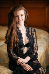 slender young bride in a beautiful black lingerie