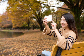 Young woman take photo at outdoor park
