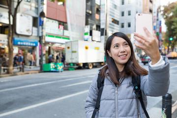Woman taking selfie at Shibuya of Japan