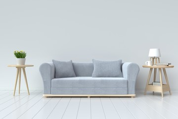 The interior has a gray sofa and lamp on empty white wall background,3D rendering