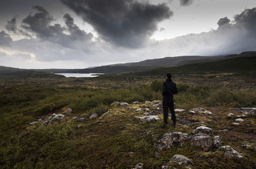 Rear view of man standing in rural landscape, Iceland