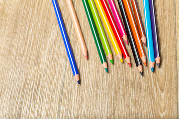 colour pencils on wooden background