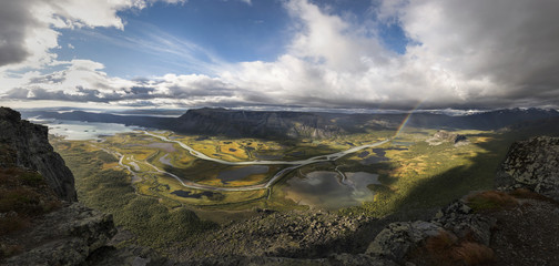 Big panorama from Skierfe top mountain over viewing rapadalen river valley beautiful autumn coloration and rainbow