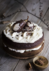 Chocolate cake with pears on wooden table