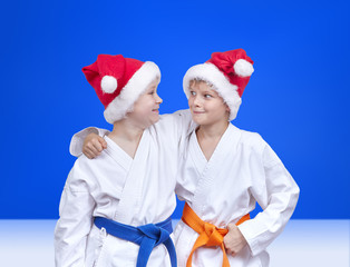 Cheerful athletes in caps of santa claus