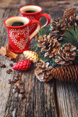 Two cup of coffee, pine cones and New-Year decorations