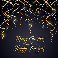 Christmas and New Years tinsel on dark background